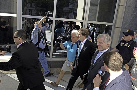 Former Gov. Bob McDonnell walks into court accompanied by his legal defense team.