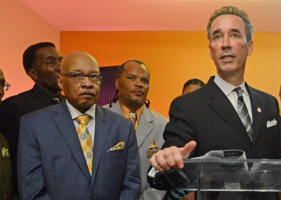 Former mayor Leonidas Young stands next to Joe Morrissey shortly after Morrissey pleaded guilty to contributing to the delinquency of a minor. - SCOTT ELMQUIST