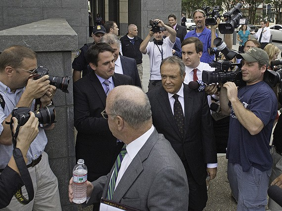 Former Star Scientific CEO Jonnie Williams is surrounded by reporters outside the Richmond federal courthouse.