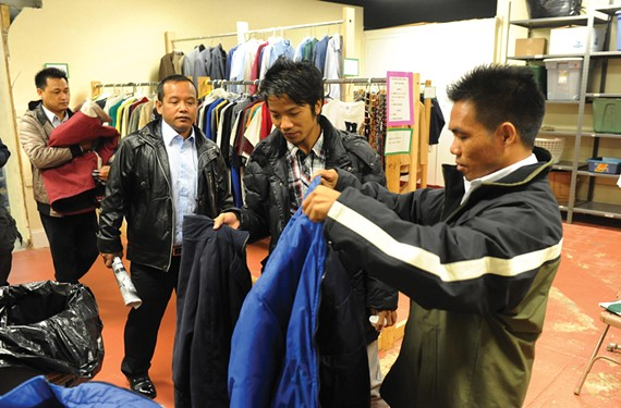 Four of the newest refugee arrivals from Burma collect coats from Tabernacle's clothes closet.