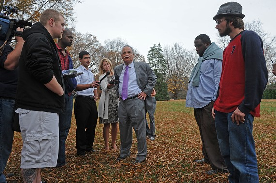 Free Press Publisher Ray Boone welcomes Occupy Richmond protestors, and the media, to his front lawn Tuesday. - SCOTT ELMQUIST