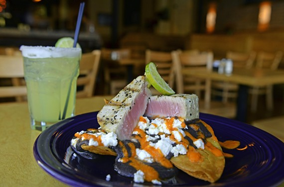 Fresh, rare tuna arrives on top of black bean purée and sprinkled with goat cheese at Continental Divide.