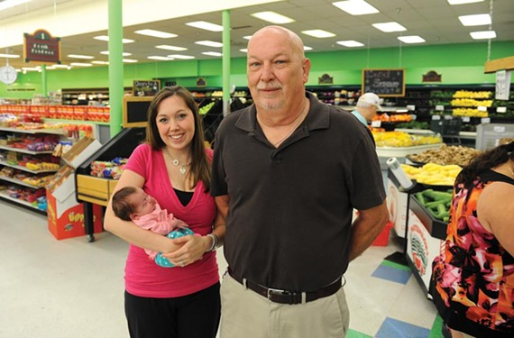 Fresh to Frozen's Junior Southard with future owners Jessica Cason and 6-week-old Paisley. - SCOTT ELMQUIST