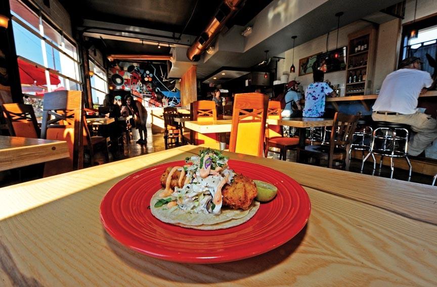 Fried fish tacos top the menu at En Su Boca on the Boulevard. - SCOTT ELMQUIST