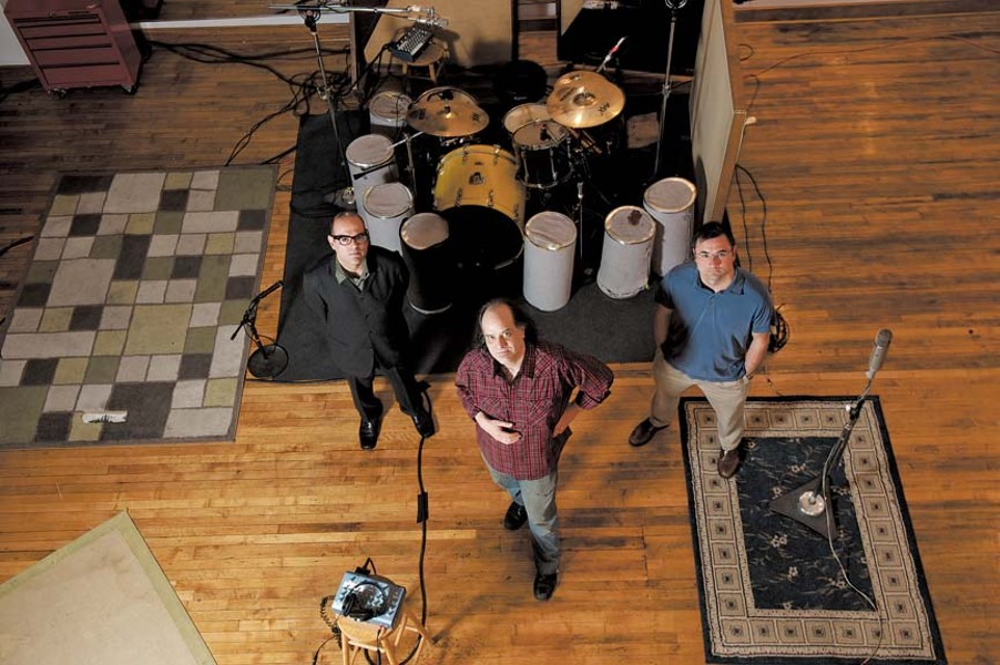 From left, Miguel Urbiztondo, John Morand and Kyle Crosby are rolling tape in the new Sound of Music studios on North Foushee Street. - SCOTT ELMQUIST