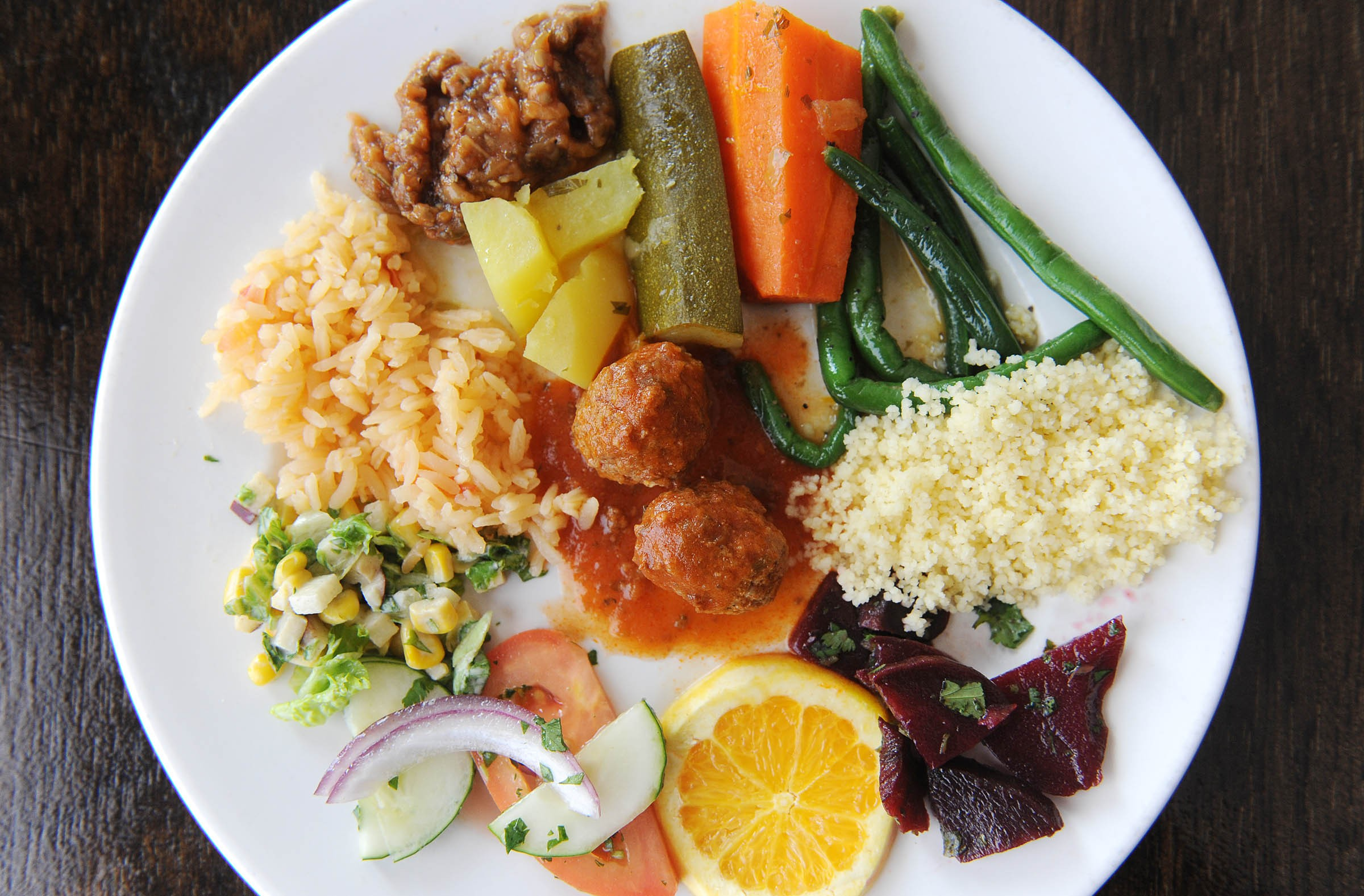From the lunch buffet at Riad Moroccan Grill, green beans, beet salad, cucumber and tomatoes, apple salad, beef meatballs, potato stew, eggplant, rice, couscous, carrots and zuvvini make a flavorful meal for a reasonable price. - SCOTT ELMQUIST