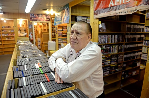 George Rosenson has run his video store for 30 years, watching the neighborhood change. As video rentals fall off, which he acknowledges is a separate issue, he survives by offering a large selection of adult titles. - SCOTT ELMQUIST