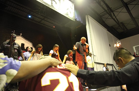 Geronimo Aguilar leads the Richmond Outreach Center's congregation in a prayer during a Saturday evening service in January 2010, before his recent resignation. - CHRISTINE LOCKERBY