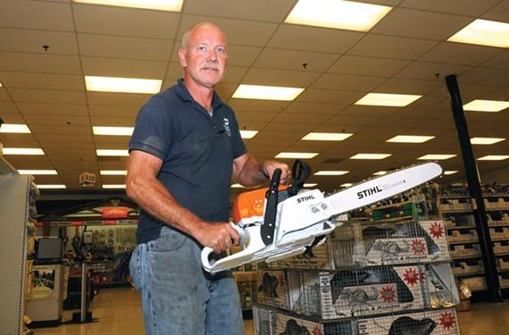 Glenn Jensen, a forklift operator at Southern States off Alverser Drive in Midlothian, with a badass Stihl chain saw. - SCOTT ELMQUIST