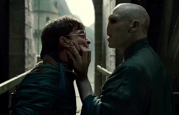 """Got your nose!"" Daniel Radcliffe and Ralph Fiennes get up close and personal in the new, awkwardly titled, ""Harry Potter and the Deathly Hallows Pt. 2."" - WARNER BROS. PICTURES"