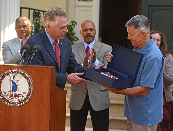 Gov. Terry McAuliffe presents Stone Brewing Co. president Steve Wagner a Virginia flag to fly over the Richmond brewery the company announced Thursday.