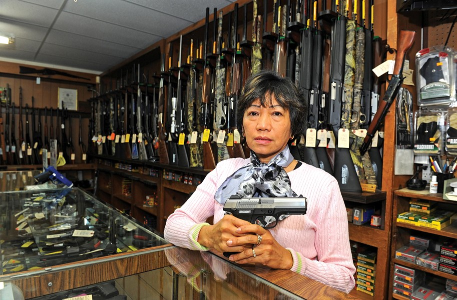 Grace Moates, here with a 9 mm Ruger pistol, says a run on ammunition sales started when Barack Obama was elected president. - SCOTT ELMQUIST