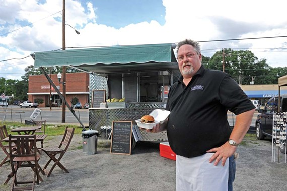 Grass-fed burgers at Meat on the Street, Henry Reidy's new food cart, are tops on a simplified menu. - SCOTT ELMQUIST