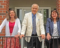 Greg Pearson, center, with Advertising Director Carol McCracken and Editor Nancy Nusser (right).