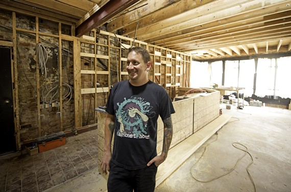 Gwar guitarist Michael Derks shows progress on first-floor renovations at 217 W. Clay St., where GwarBar will open in the former Crossroads.
