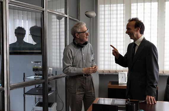 """Hardly working? Director Woody Allen speaks with actor Roberto Benigni on the set of """"To Rome With Love."""" - PHILIPPE ANTONELLO"""