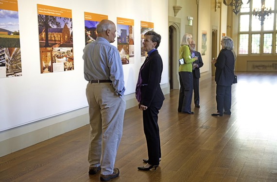 "Helene Dreiling, the Virginia Center for Architecture executive director, chats with a guest Oct. 30 at the opening reception of ""Design 2014,"" a juried show. - SCOTT ELMQUIST"