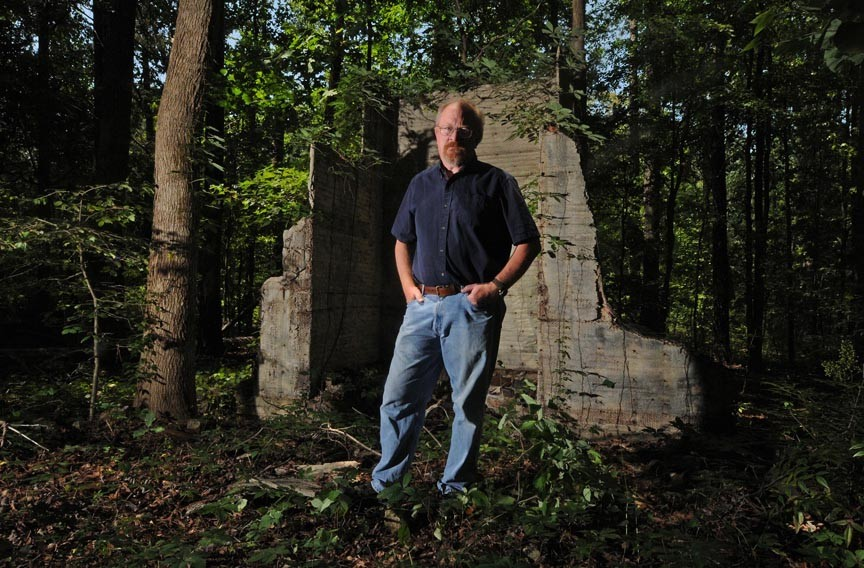 Historian Selden Richardson stands at the ruins of Club Forest in Goochland County, the one-time hangout of the Tri-State Gang. - SCOTT ELMQUIST