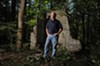 Historian Selden Richardson stands at the ruins of Club Forest in Goochland County, the one-time hangout of the Tri-State Gang.