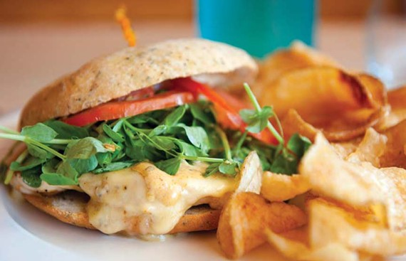 House-made potato chips give extra flavor and value to the Kickin' Chicken sandwich at the Mill on MacArthur. - SCOTT ELMQUIST