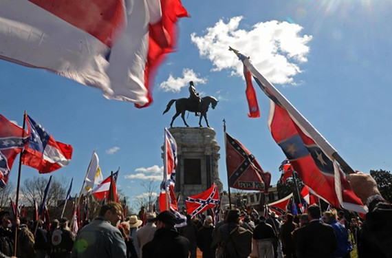 "Hundreds of Confederate sympathizers descended on the Robert E. Lee statue Saturday afternoon, bemoaning Lincoln and the Northern ""invasion"" of the South. - SCOTT ELMQUIST"
