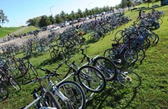 Hundreds of people rode their bikes to the Richmond Folk Festival in October. Cycling advocates hope the city's winning bid to host an international cycling championship in 2015 will spur Richmond to become a truly bike-friendly town.