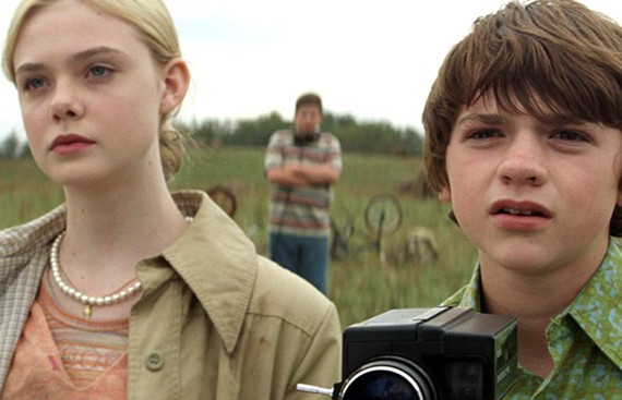 """I think we're going to need a bigger camera."" Elle Fanning and Joel Courtney star in the wayward Steven Spielberg homage, ""Super 8."""