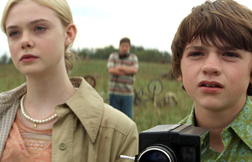 """""""I think we're going to need a bigger camera."""" Elle Fanning and Joel Courtney star in the wayward Steven Spielberg homage, """"Super 8."""""""