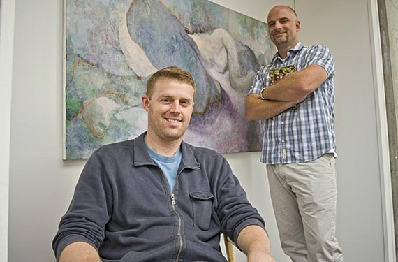 """Illustrator Sterling Hundley, left, will see his book, """"Blue Collar/White Collar"""" released on the AdHouse imprint next month. The local publishing company, headed by Chris Pitzer, specializes in art books, graphic novels and comics. - ASH DANIEL"""