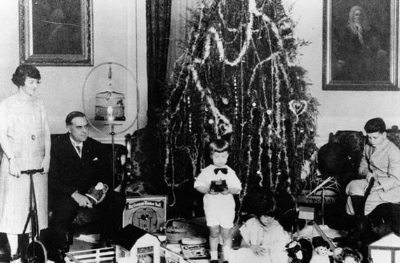 In 1925, Gov. E. Lee Trinkle and his family celebrate the holidays in the mansion ballroom. A few days later, the Trinkles and officials survey extensive damage caused by son Billy's accidentally setting the Christmas tree on fire (below). - LIBRARY OF VIRGINIA