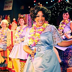 In Swift Creek Mill's bouncy Christmas musical, Katrinah Lewis (third from left) wonders who put the bomp in the shama lama ding dong.  Fellow Wonderettes Aly Wepplo, Georgia Rogers Farmer and Anna Starnes offer their own backup analysis.