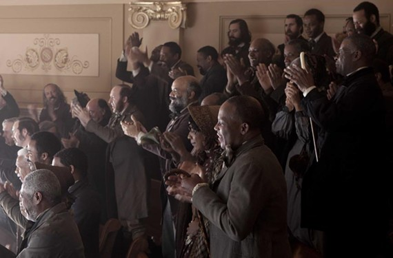 In the balcony of Virginia's House of Delegates, which doubles as the chamber of U.S. Congress, the writer — several rows from left — joins extras playing onlookers who celebrate the passage of the 13th Amendment. - DREAMWORKS PICTURES