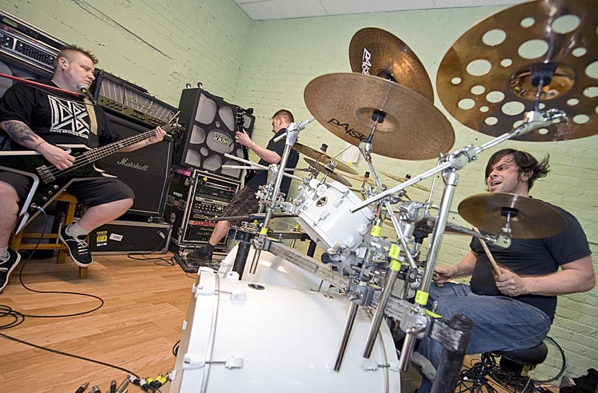 Inside the Slave Pit, located in Scott's Addition, band members Jamison Land, Mike Derks and Brad Roberts rehearse at their onsite studio.