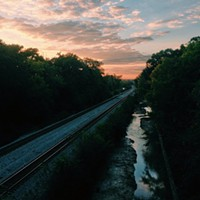 #HiddenRVA on Instagram Instagram by: Johnny Hugel (@Hugel)Where: On the north side of the Nickel Bridge overlooking the train tracks.What caught my eye: The sunset that week had been amazing every night and my girlfriend and I both marveled at it as we crossed the bridge. We pulled over by the Pump House to run and snag a photo of the river, but before we made it that far I noted the reflection in the creek.