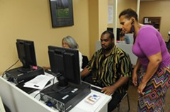 Instructor Myra Griffin works with public-housing residents Gwendolyn Coles and Abraham Harris on their résumés and online applications.