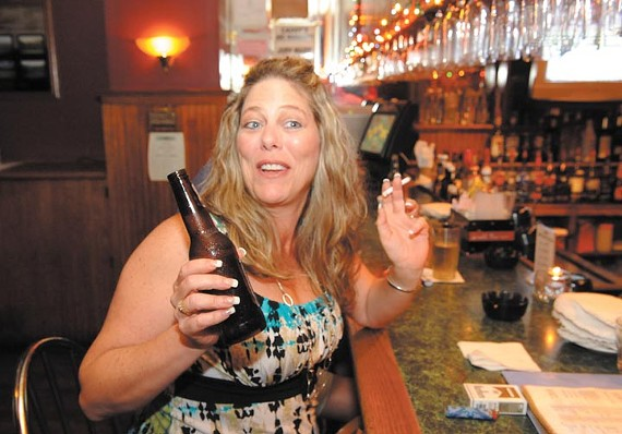 Janet Owen enjoys a Marlboro Light with her beer at Caddy's. - SCOTT ELMQUIST