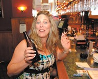 Janet Owen enjoys a Marlboro Light with her beer at Caddy's.