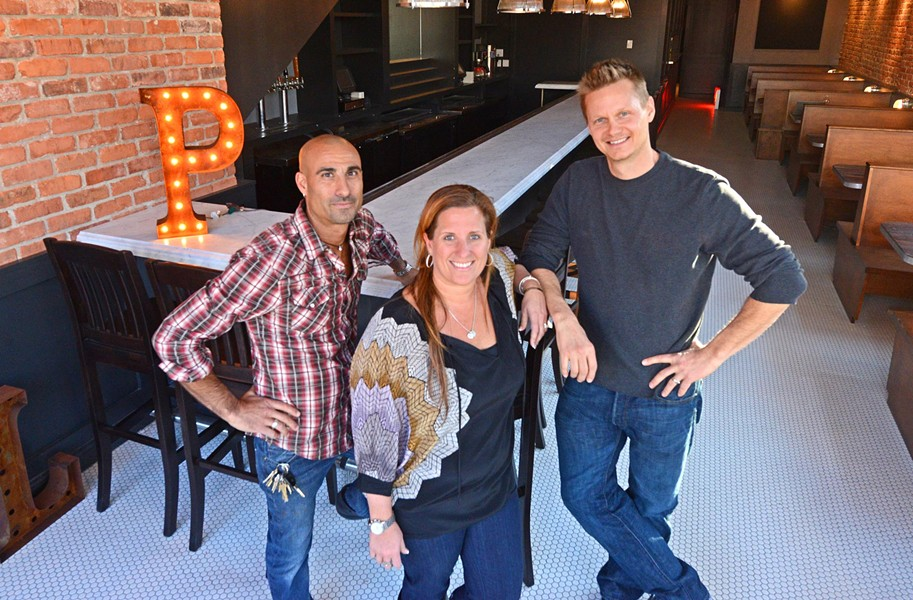 Jared Golden, Michelle Williams and Ted Wallof are finishing a redesign of DeLux in the Fan, turning it into Pearl Raw Bar, which they hope to open this month. - SCOTT ELMQUIST
