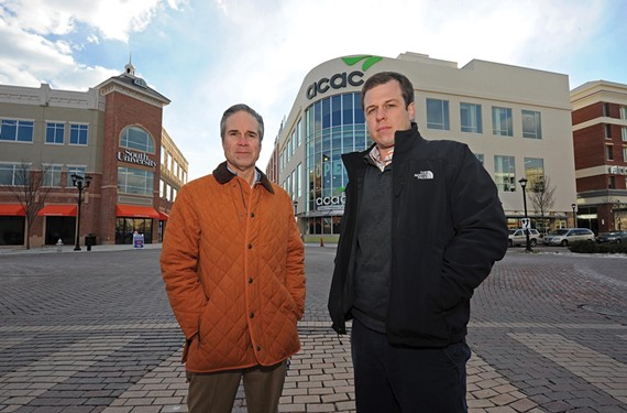 Jeffrey Doxey, president of NAI Eagle Commercial Real Estate Services, Worldwide, at left, and Peter Vick, vice president, oversee commercial development of West Broad Village, outside the ACAC fitness center and South University on Old Brick Road. Two additional restaurants, Chuy's and Carrabba, will soon join the restaurant mix. - SCOTT ELMQUIST