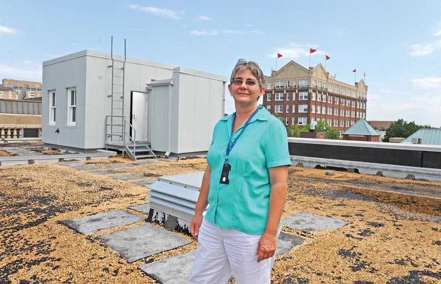 Jennifer Wampler, a spokeswoman for the Richmond Hostel Committee, says the new hostel at 7 N. Second St. will feature a garden on the roof. - SCOTT ELMQUIST