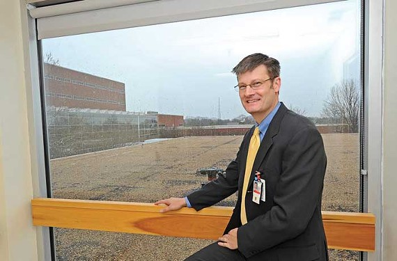 Jim Dudley, chief engineer at McGuire Veterans Medical Center, is overseeing $30 million in renovations. Next month, a 20,000-square-foot addition for brain-injury care will begin rising on the roof behind him. - SCOTT ELMQUIST