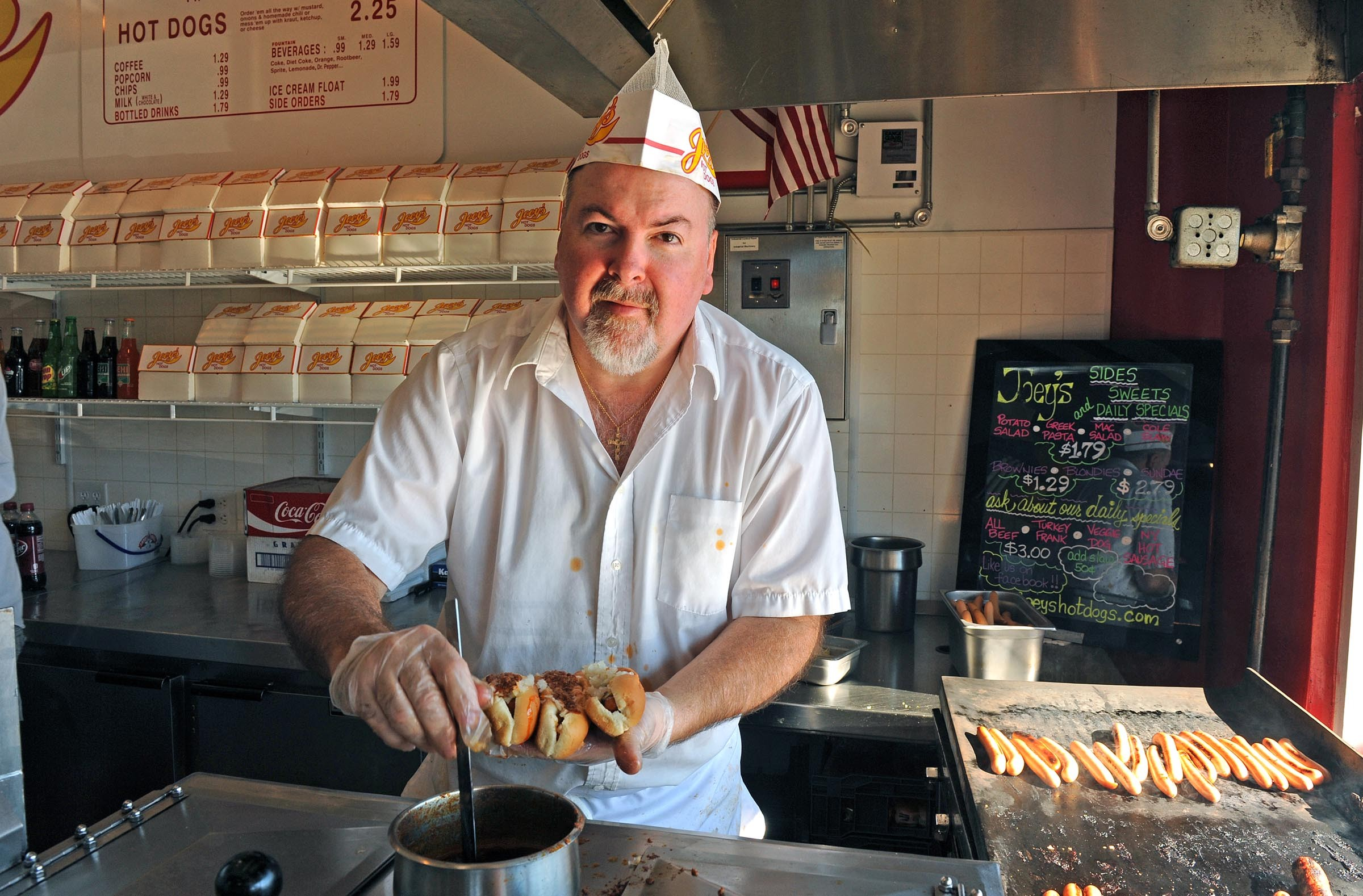 """Joey Mirabile of Joey's Hot Dogs was a vocal and visible critic of the meals tax measure. For a while, his meals came with """"no meals tax"""" fliers. - SCOTT ELMQUIST"""