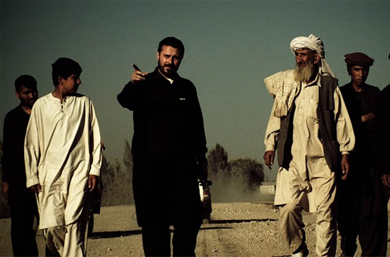 """Journalist, author and filmmaker Jeremy Scahill, pointing, got his start on the daily news show, """"Democracy Now."""" - IFC FILMS"""