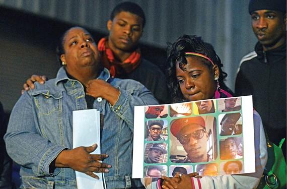 Kenna Hertsch attends a vigil Nov. 15 in memory of her cousin Amari Hill, a trans woman who was murdered near her Gordon Avenue home where the vigil was held. - SCOTT ELMQUIST