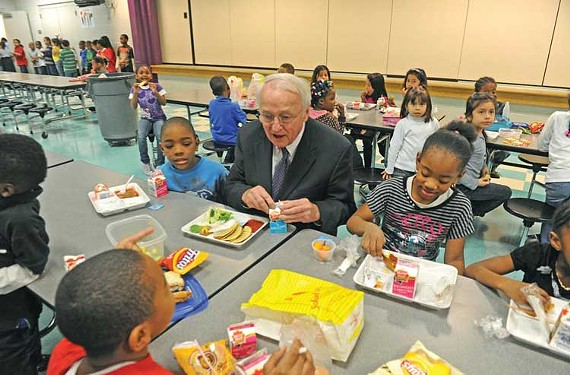 Kevin Concannon of the Agriculture Department joins Richmond schoolchildren for a lunch of whole-grain bean tacos, baked corn dogs and salad. - SCOTT ELMQUIST