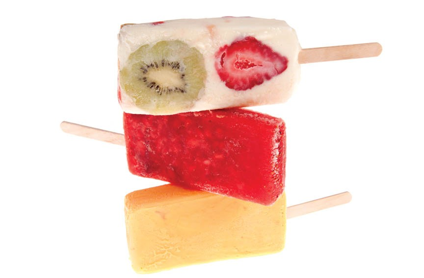 Kiwi with strawberry, watermelon and rompope (eggnog) popsicles at La Michoacana put fruit forward in refreshing summertime treats. - SCOTT ELMQUIST