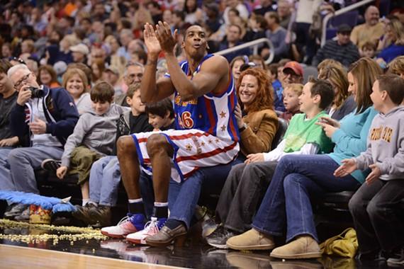 "Kris ""Hi Lite"" Bruton takes a break from monster dunks during a Harlem Globetrotter game."