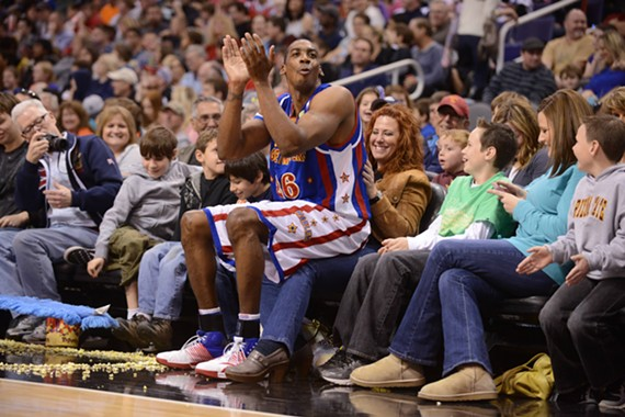 "Kris ""Hi Lite"" Bruton takes a break from monster dunks during a Harlem Globetrotter game."