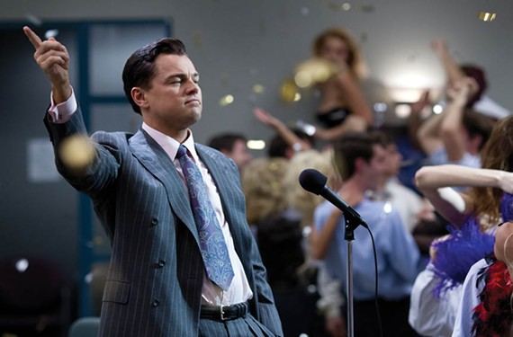 "Leonardo DiCaprio gives an unhinged performance in the ""Wolf of Wall Street"" as a master salesman who can't get enough cocaine or naked ladies before breakfast."