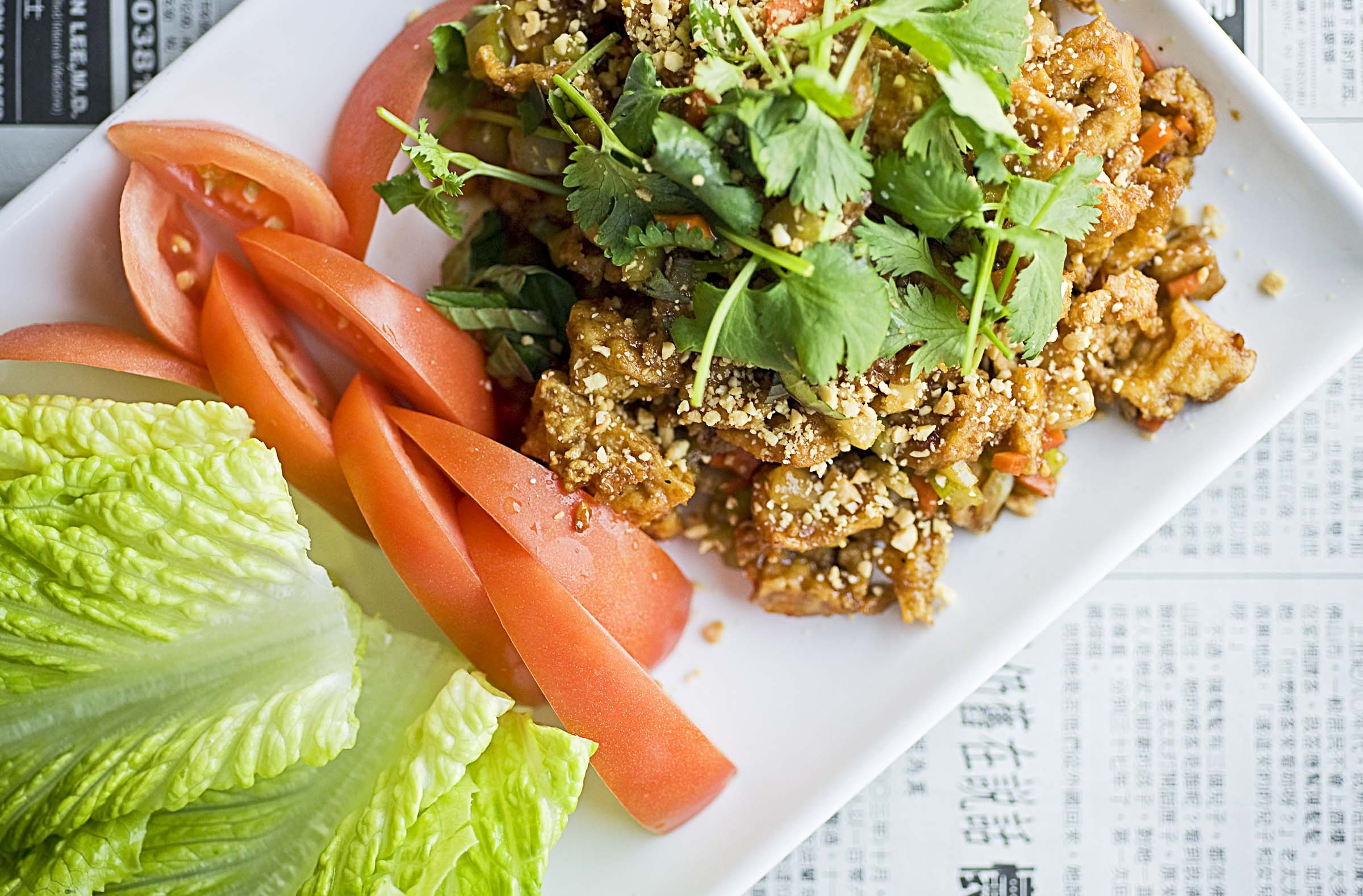 Lettuce wraps are a crisp starting point for a meal at Green Leaf Vegetarian on West Broad Street in Henrico. - ASH DANIEL